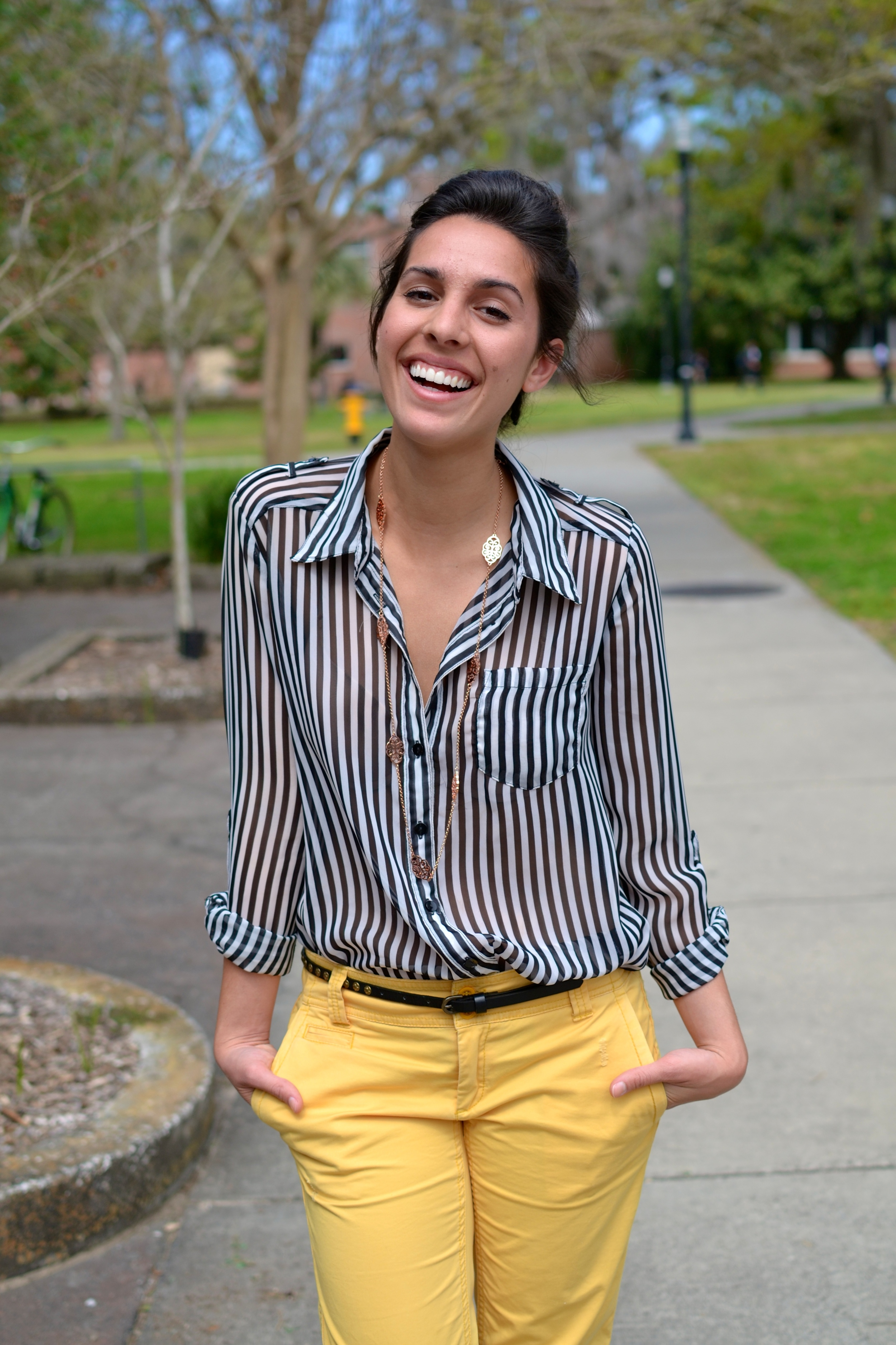 Kelsey Hernandez University of Florida Macy's striped sheer blouse and yellow khaki pants Gap. Thin studded brown belt.