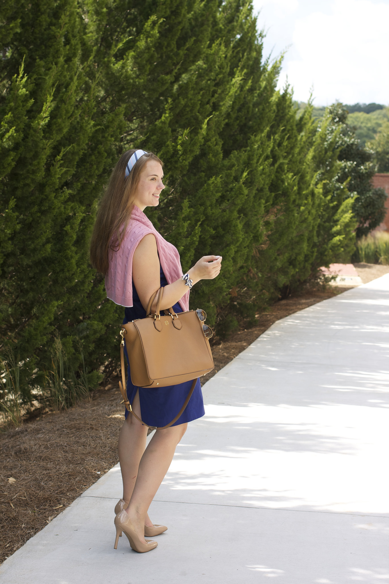Nicole Stephens | University of Georgia   Nicole is wearing a Brooks Brothers sweater with a Vineyard Vines headband and Tory Burch tote. The pearl stud earrings and necklace are, of course, gifts and family heirlooms, as they should be.