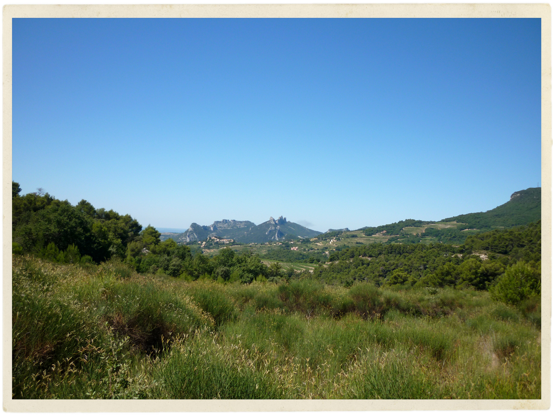 View back to the Dentelles from Col de la Chaine. Check out that amazing blue sky!