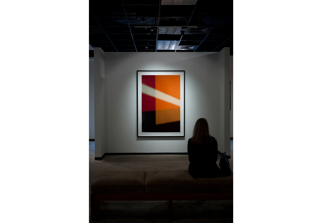 Viewer contemplates  Right On , a geometric abstraction by perceptualism photographer Steven Silverstein at Esperson Gallery.