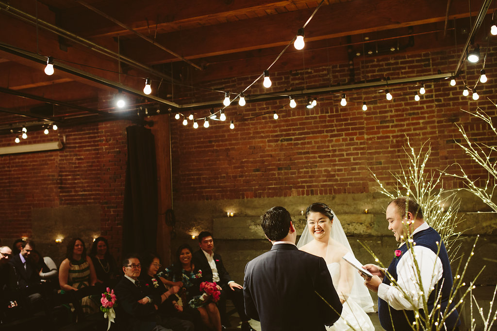 bride_and_groom_at_alter