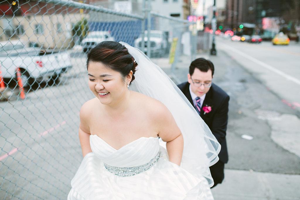 groom_holds_brides_train