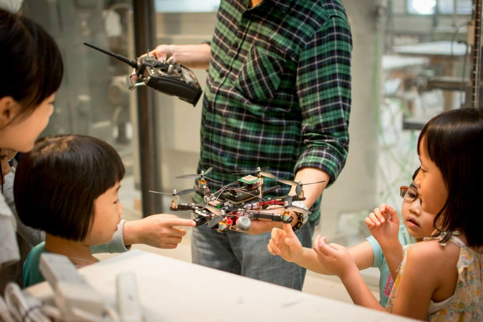 Children are introduced to drones by a workshop teacher.