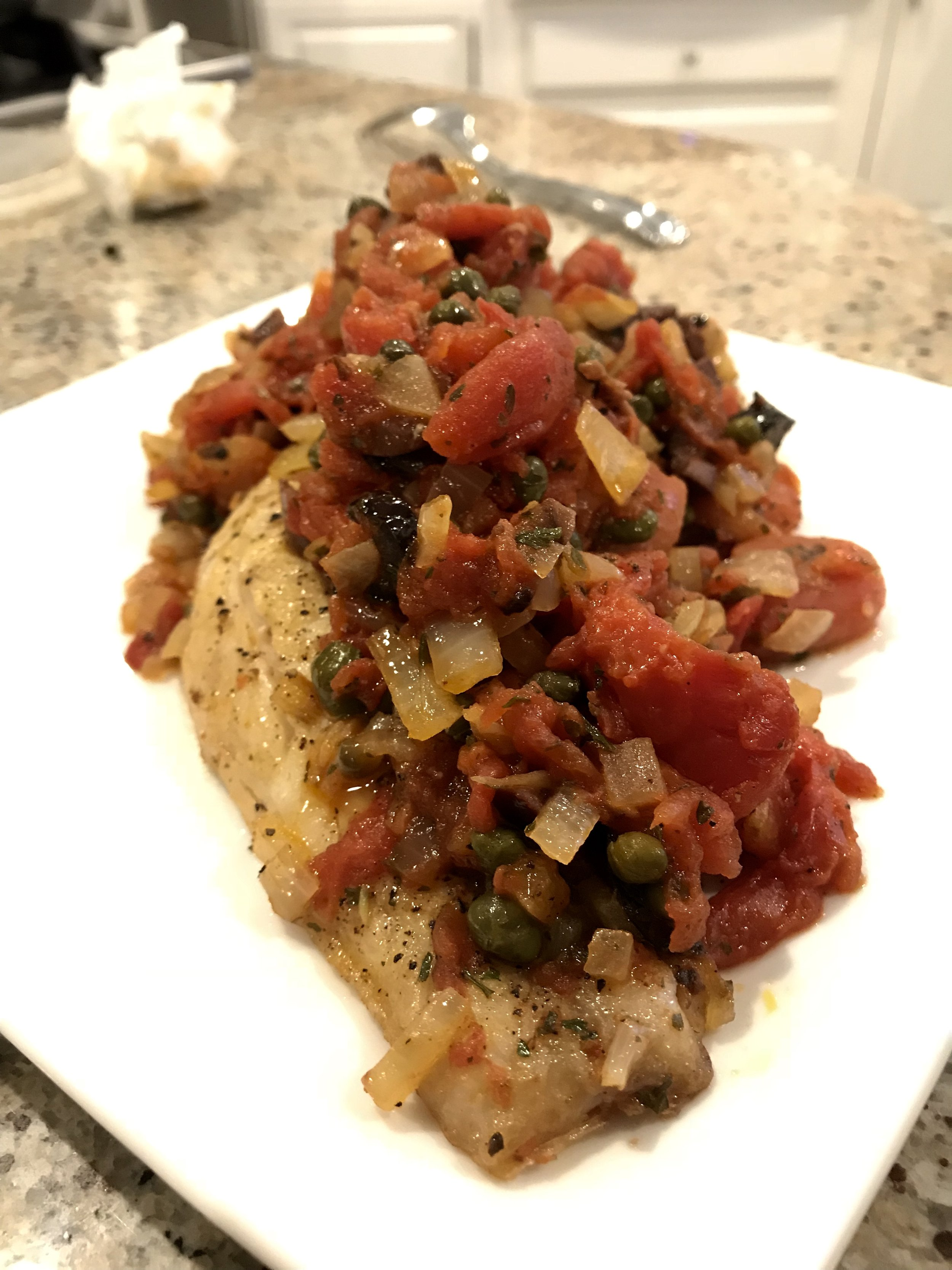 - 2 Red Snapper Fillets, skin on1 Yellow onion, diced1 28oz Can of Plum Tomatoes, hand crushed1/2 Cup Kalamata or Black Olives, chopped1-2 Tbsp Capers (rinsed if they're salted)Fresh Parsley & BasilEVOOS&P