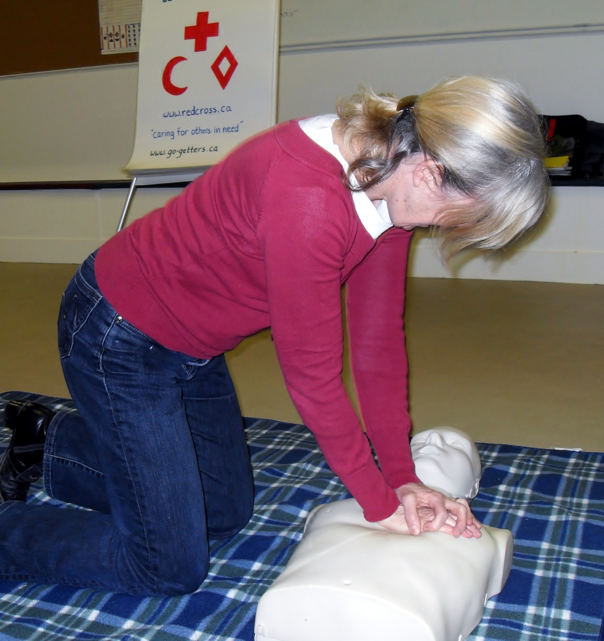 woman practicing CPR