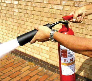 fire extinguisher in use.jpg