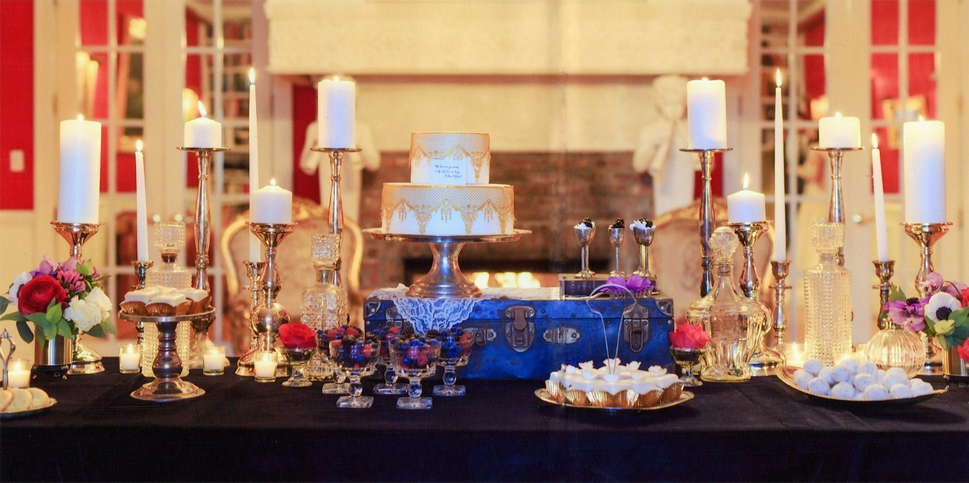Petit cakes and petit fours on dessert table for a traditional French themed wedding event