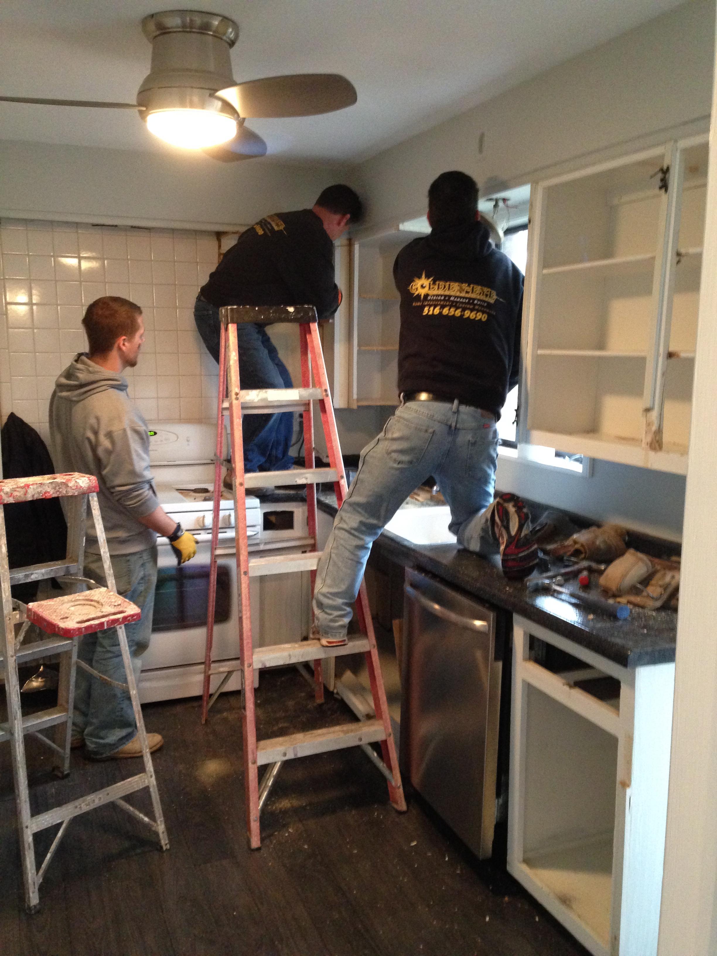 Crew Gutting Original Kitchen.
