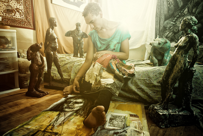 Environmental Portraiture: Jeffrey with selected pieces of his work, in his room.