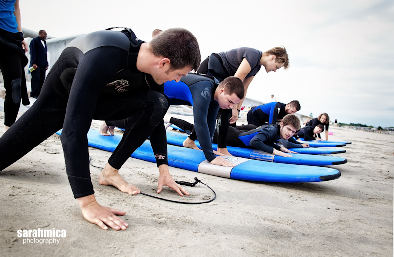 Dan shows the adventurists how to stand up on a surf board