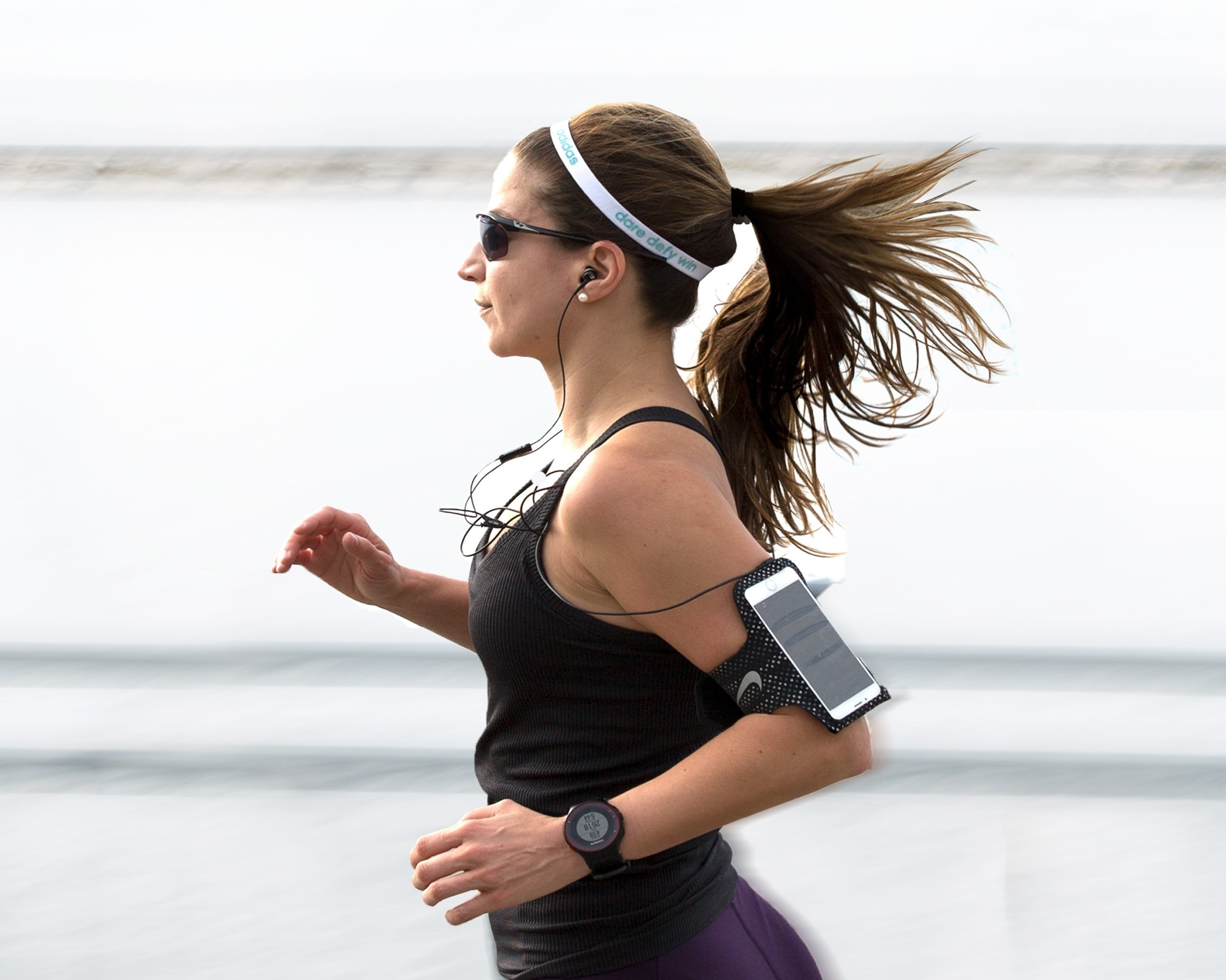 Photo by Filip Mroz on Unsplash - Writing and Jogging. This is  not  a photo of me (unlike me, she's rockin' the Spandex).