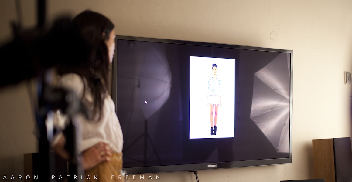 """Stylist checking out real time photos on the 65"""" plasma. Great tool for us, but be warned models... It his HI-DEF! Ouch!"""