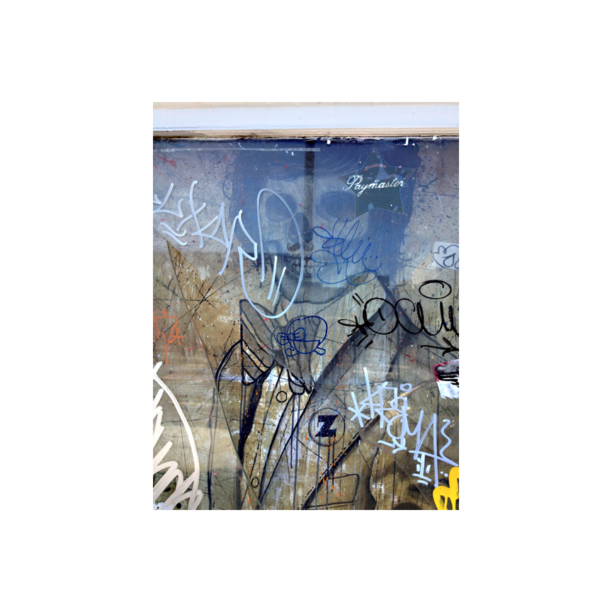 Art on Valencia, behind glass with graffiti on top