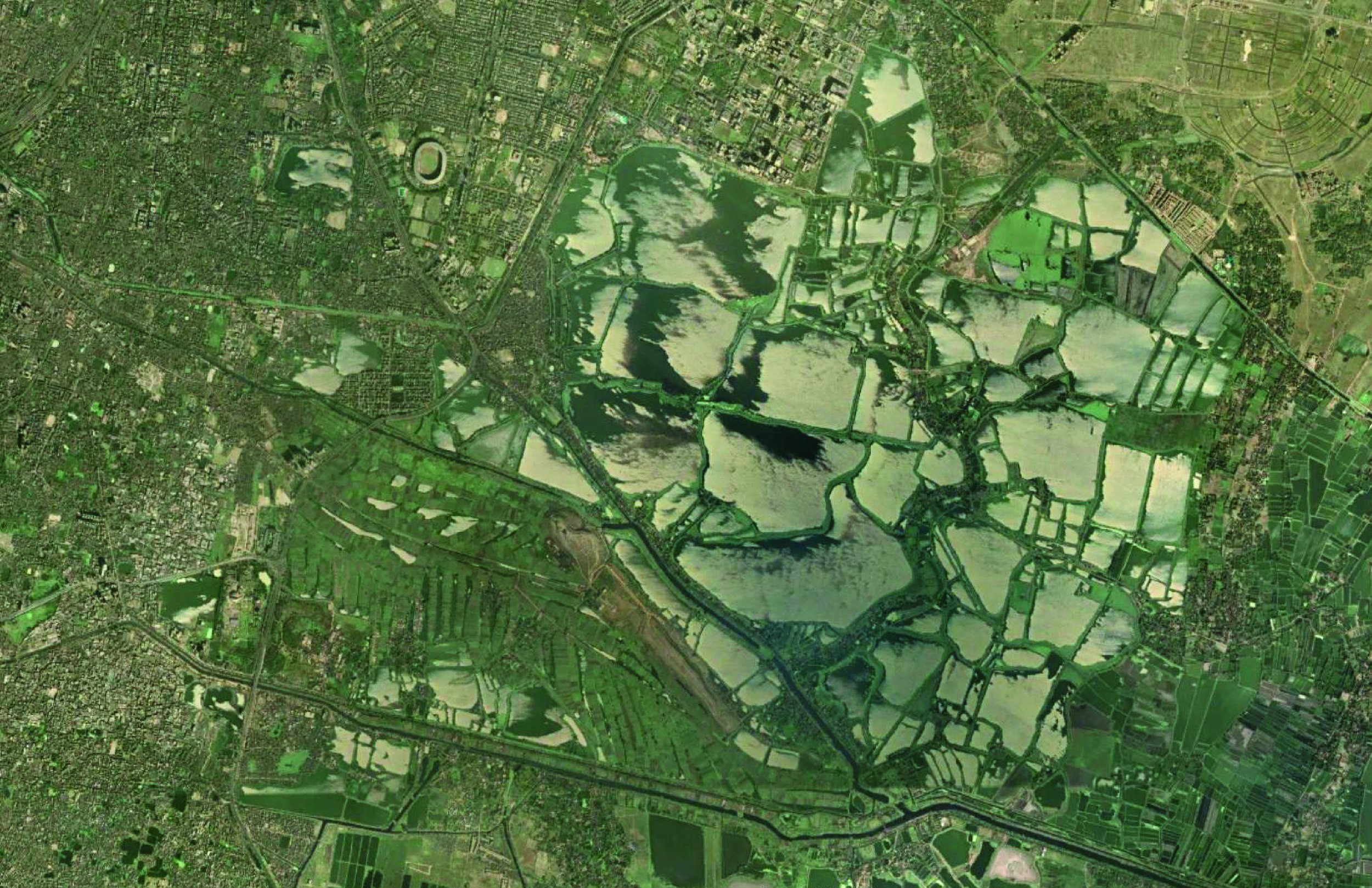 East Kolkata Wetlands in the process of draining for fertilizer harvest and maintenance of proper depth levels.
