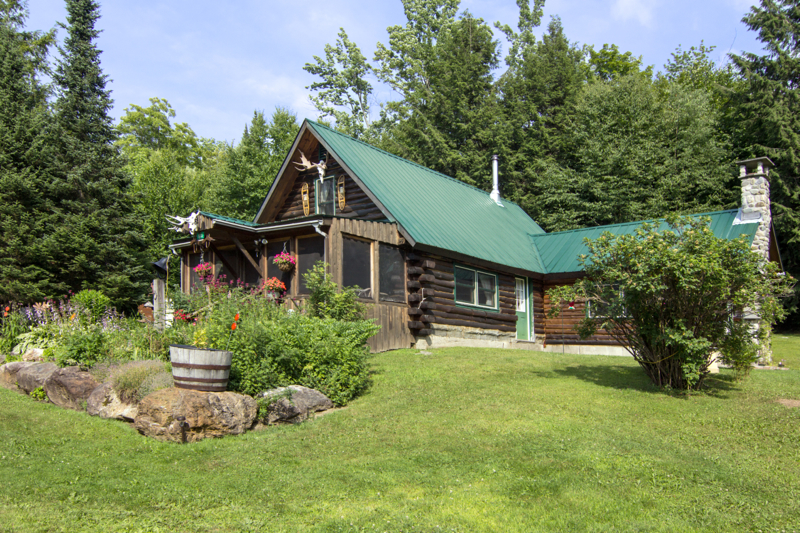 Log home on 22 totally private acres with a large 2-car garage/barn right behind me