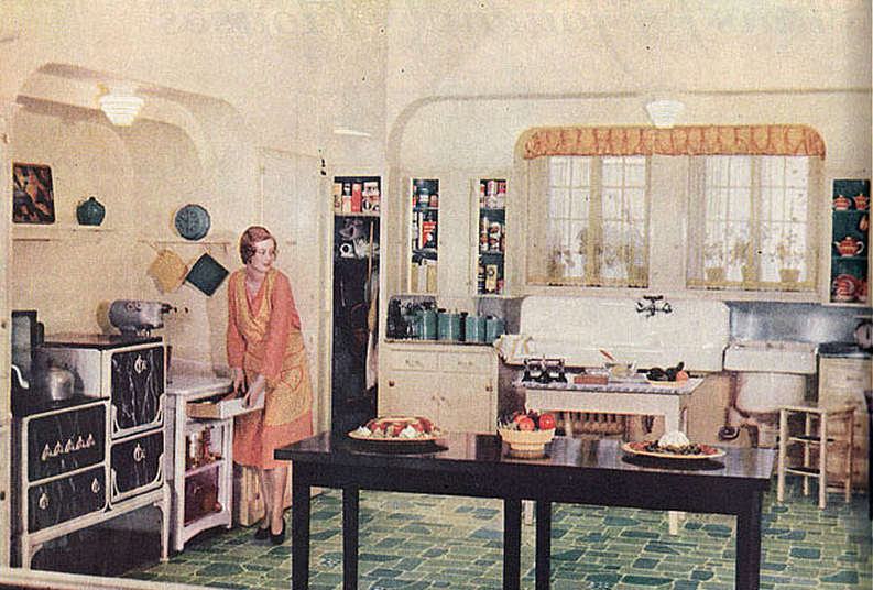 An ideal 1930's kitchen featuring state of the art appliances. Notice that the stove, oven and sink are still freestanding and not fitted. Image credit here.