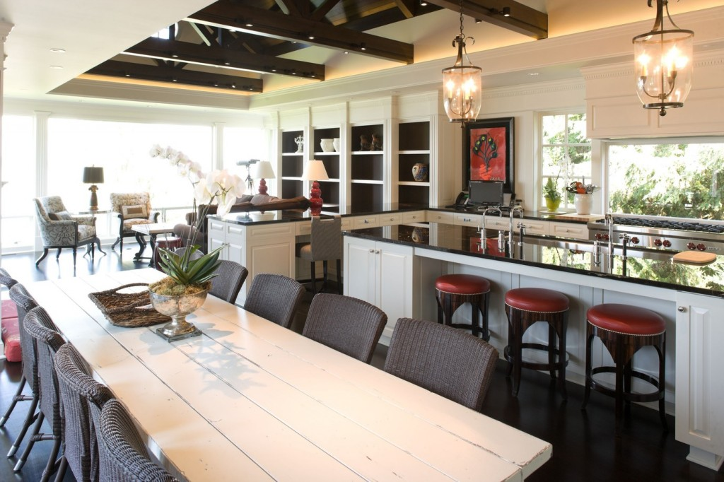 A contemporary kitchen layout with the kitchen open to the dining area and family room. Project by Hyde Evans Design.