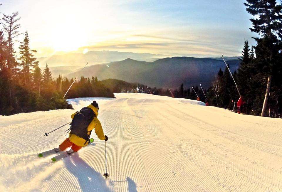 A skiier who is far more skilled than the author heads into the sunrise at Stowe Mountain Resort. Photo:  ANDERSON JAMES