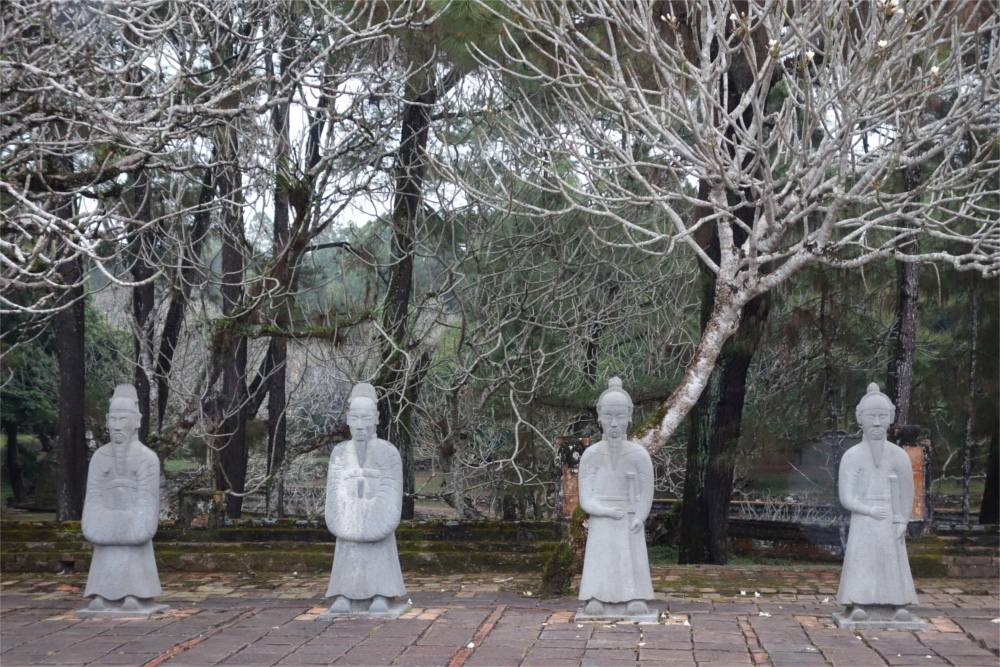 The tombs of Nguyen dynasty are top tourist attractions in Hue. Emperor Tu Duc's tomb is one of the most beautiful tombs. It has a vast sprawling complex with a calm and serene ambience, built around a beautiful lake and full of pine trees. It consists of several tombs and temples dedicated to wives, some courtesans, and other relatives.