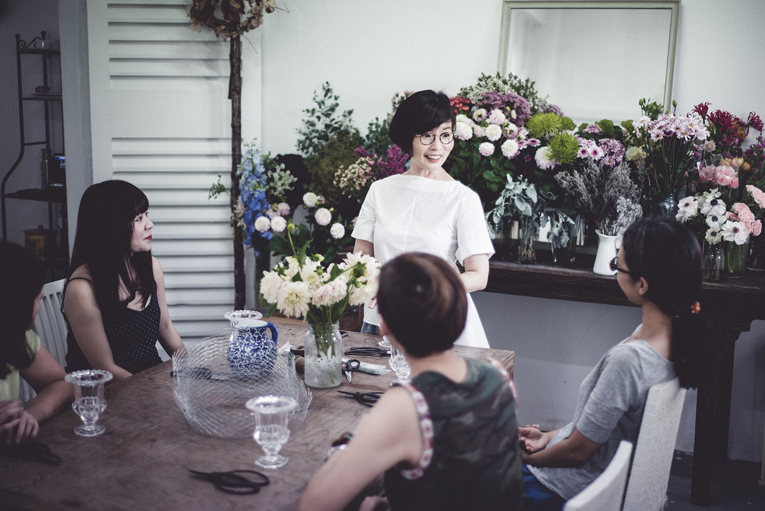 One of our talented student deeply immersed in a flower arrangement. You can be like her too.