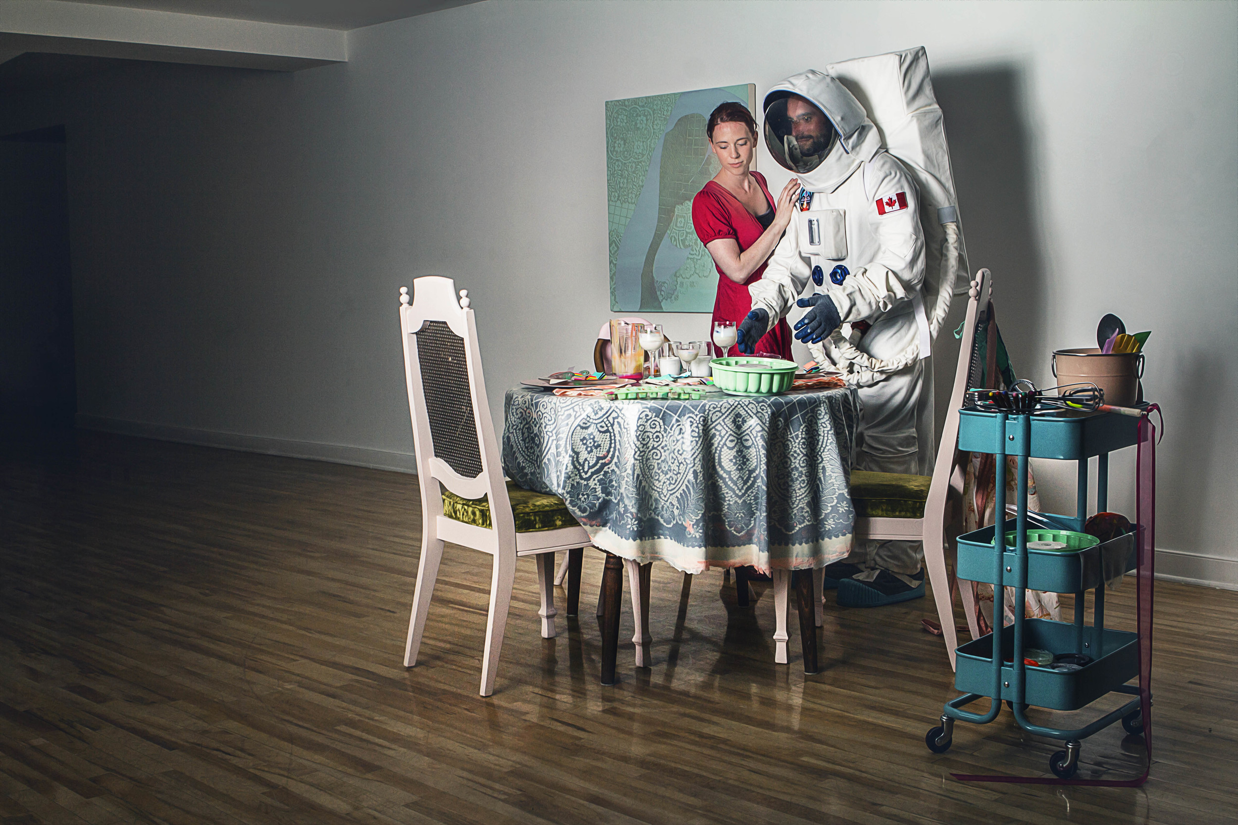 Conceptual photography  is meant to illustrates an idea. Often combining two elements that are not normally seen together, in this case, an astronaut helping his wife at home, representing the unseen life of our heros.