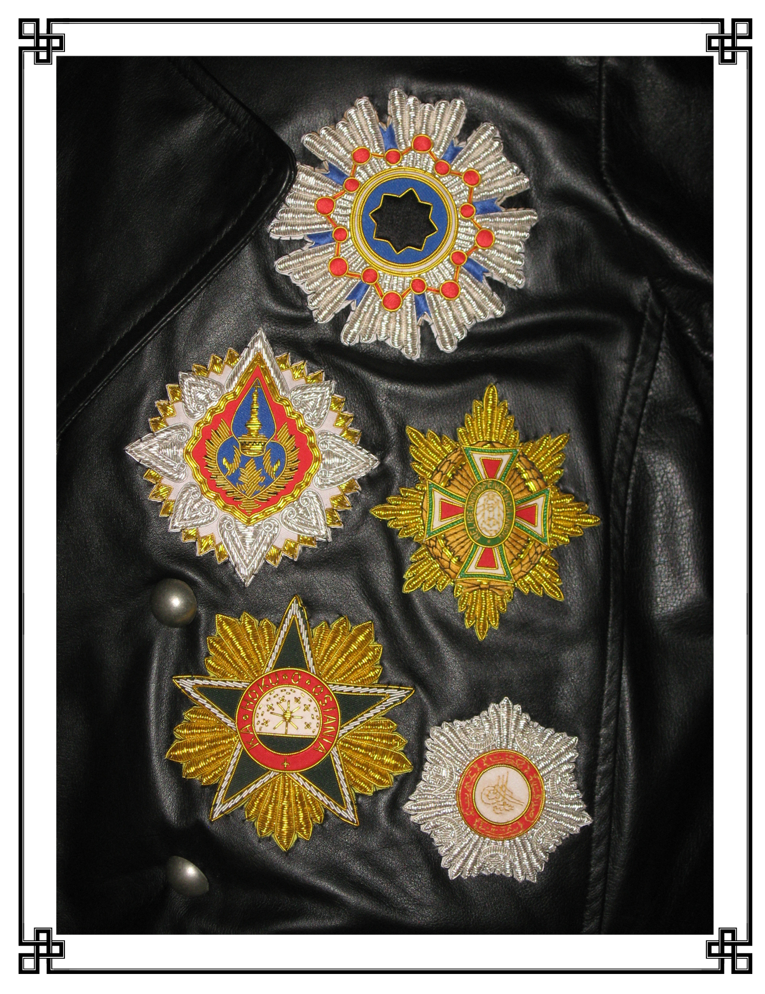 These 'like-buttons', indicative of the wearer's 'friending' by various crowned heads of state, were amongst the most sought-after complements to any court dress. While attainable through such endeavors as the painting of a bowdlerized portrait or the sycophantic dedication of a musical composition, like-buttons were most readily acquired by means of being oneself an aristocrat and, therefore, more or less distantly related to awarding monarchs and better stationed to award reciprocal 'friendings' in turn. While normally given as enameled and bejeweled badges of precious metal, the examples displayed here decorate an aviator's greatcoat. Thus, they are instead embroidered in gilt and silver thread to preclude clasp-punctures to the leather, sharp edges liable to catch on control protuberances and, in instances of extreme popularity {such as those illustrated below}, being abruptly dragged under in the event of an emergency egress over water.