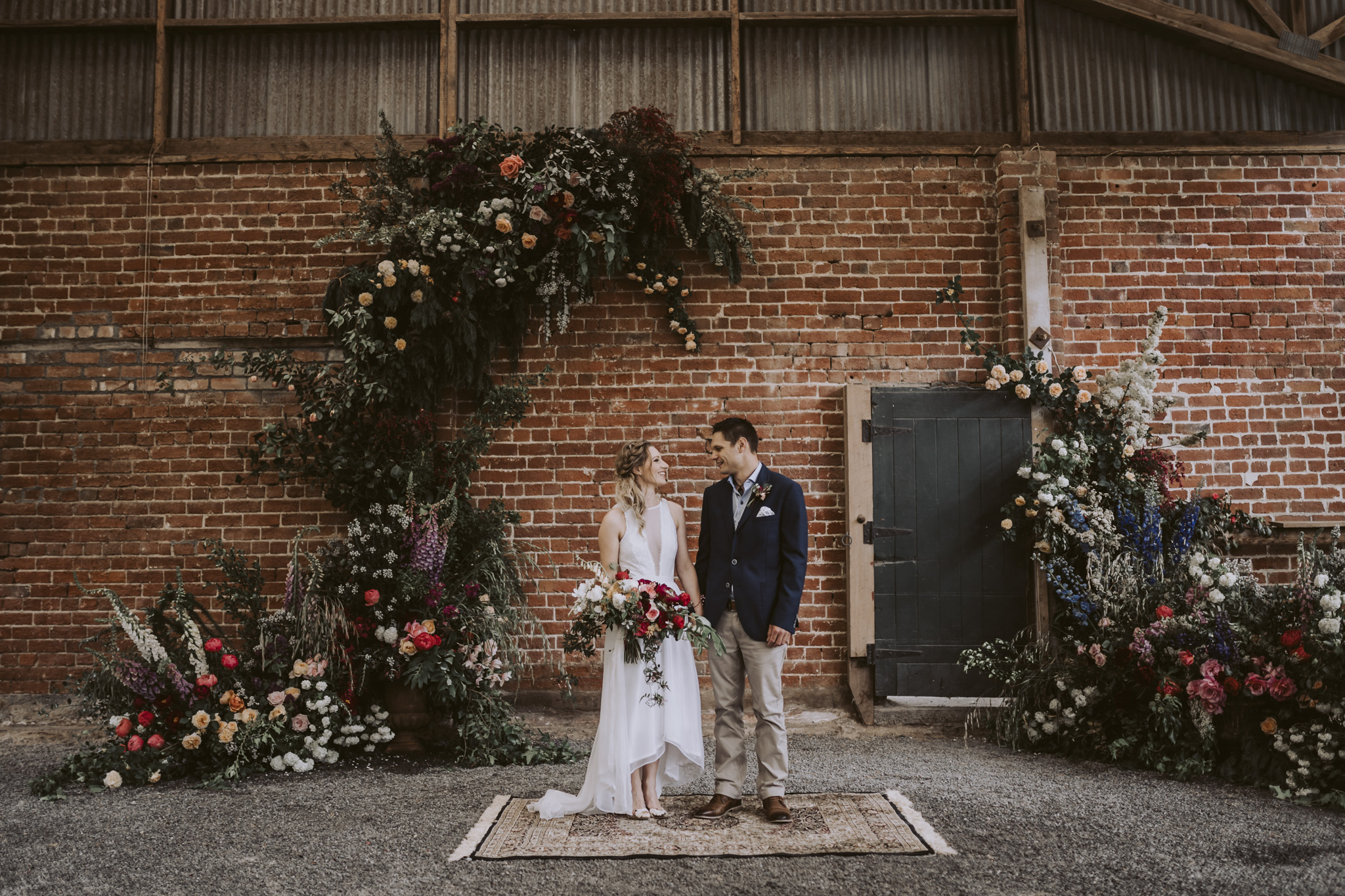 Sharni + Michael surrounded by freaking amazing floral goodness!