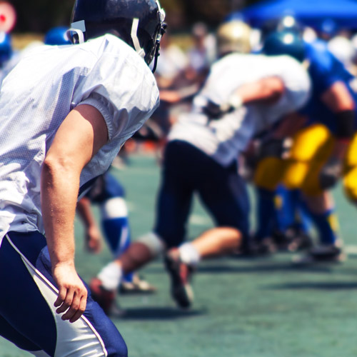 AMERICAN FOOTBALL - Helps keep hold of the ball.