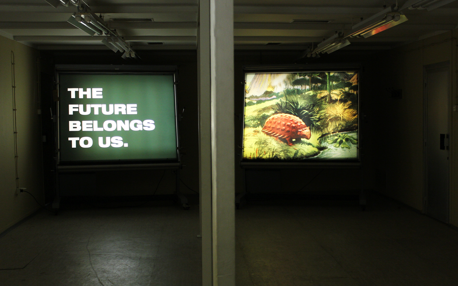 Our Prehistoric Fate, 2011, two duraclear prints on vintage Yugoslavian military lightbox displays and clamps. Prints are each 151 x 177 cm. Installation view 1st Time Machine Biennale of Contemporary Art. D-O ARK Underground, Konjic, Bosnia and Herzegovina. (photo: Vladimir Miladinovic).