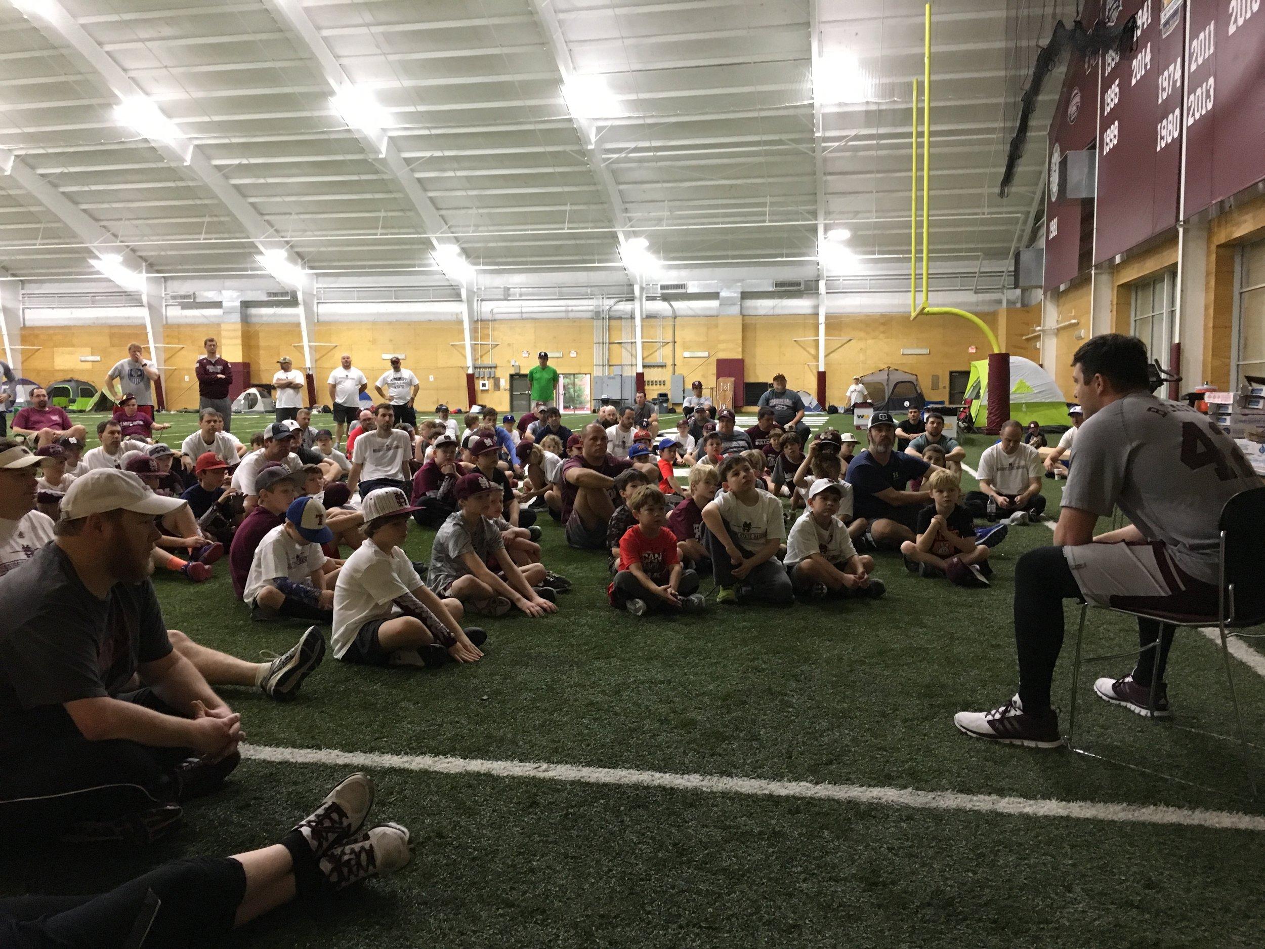 MSU pitcher Blake smith sharing his testimony at father-son baseball camp