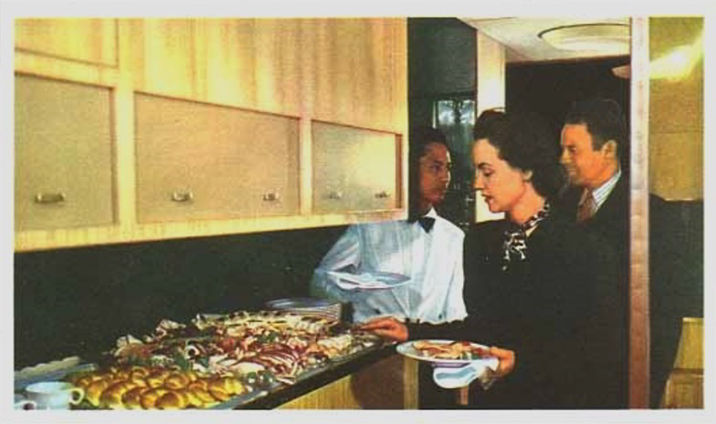 Passengers line up for the buffet in the Mainliner galley.
