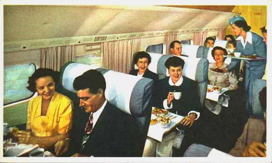Passengers in the aft cabin enjoy lunch aboard the Mainliner Stratocruiser.