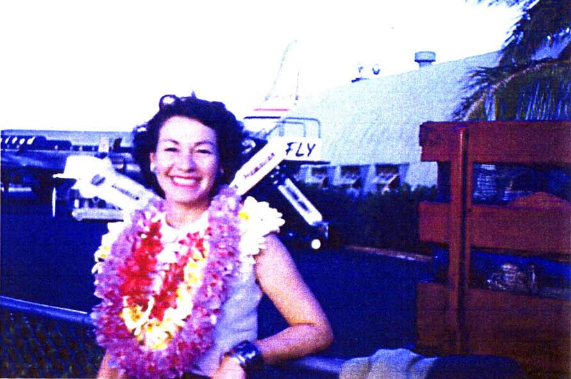 Margo Duggan posing at the Overseas Terminal in front of a United Mainliner.    (Margo Duggan Collection, 1949-1954; Pacific Collection, University of Hawaii-Manoa Library (used with permission)  )