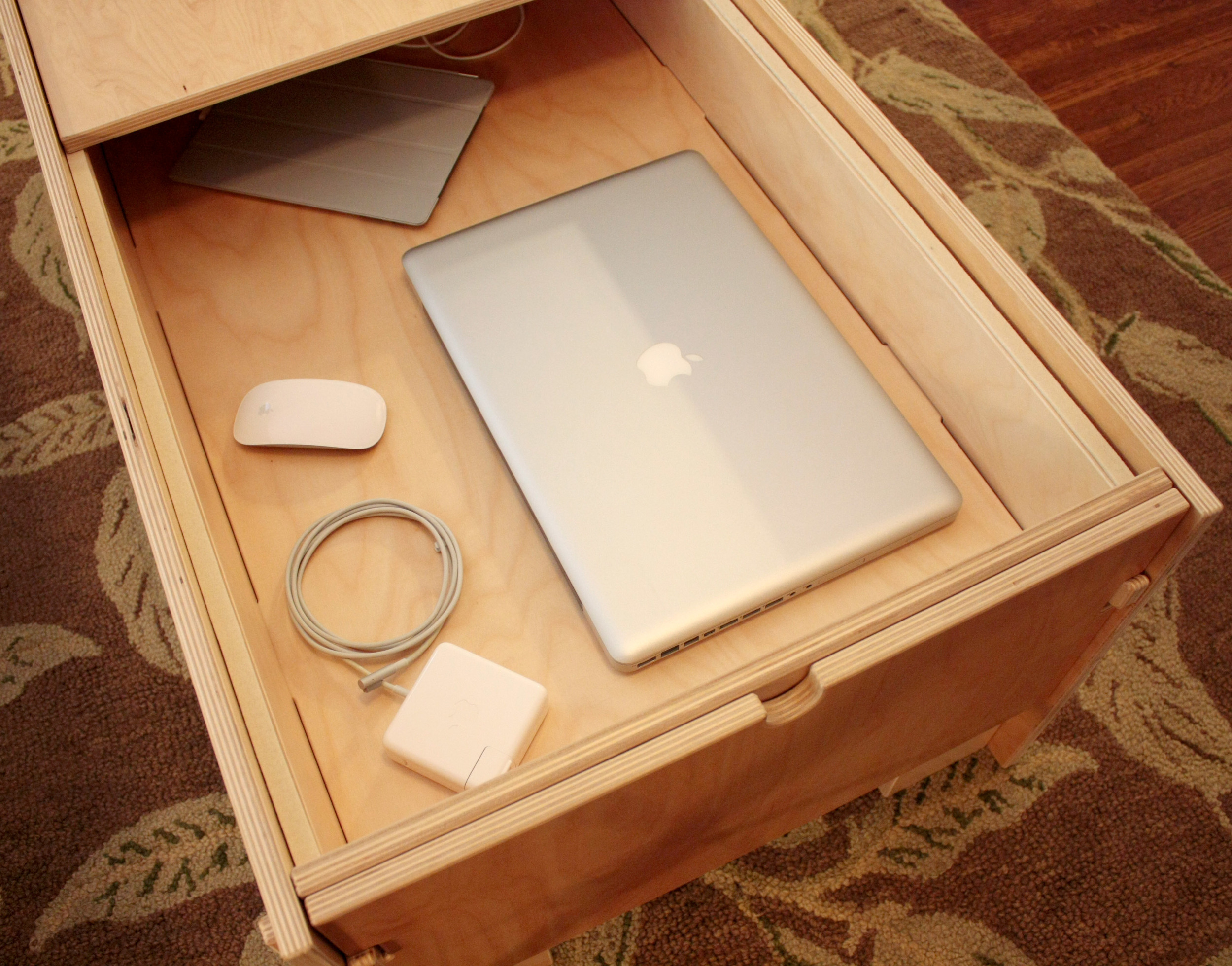 Storage Coffee Table with MacBook Pro and accessories
