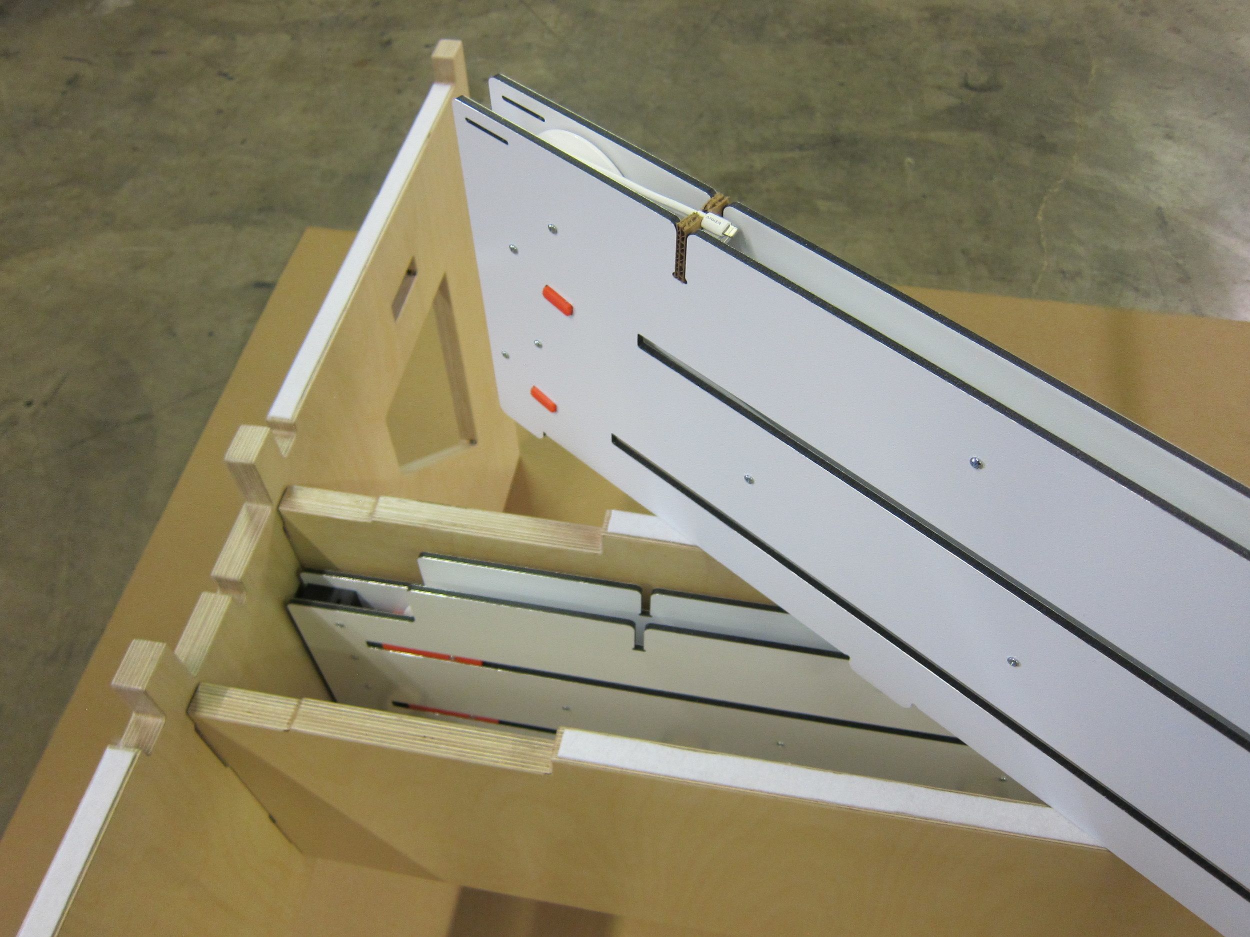 Cable retractors install into WELD Table with no tools or fasteners