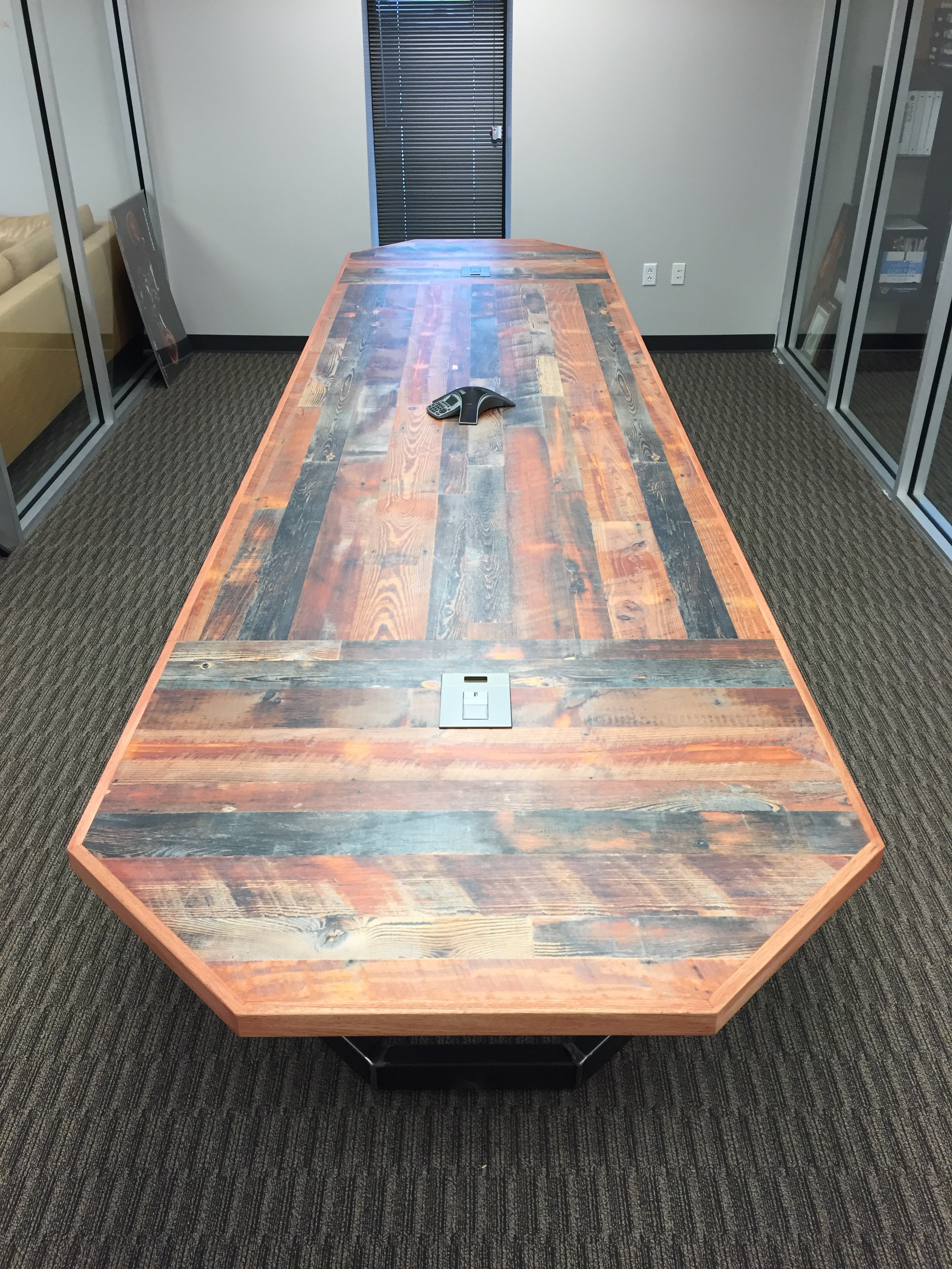 End view of the 16' conference table with built-in pop-up power outlets and USB chargers