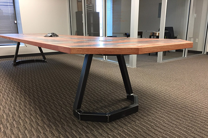 Rustic Table - Durable laminate top, real oak edging, built-in power and custom steel legs make this table a notable addition to your office.Learn More