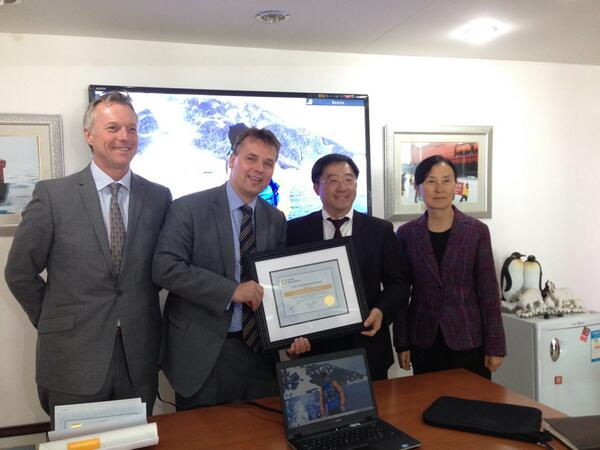 Hans Lagerweij, CEO/President of Quark Expeditions (second from left) and Kenneth Keng of Amazing Cruises (second from right) celebrating the record number of Chinese travelers to the Antarctic during 2012-13 season. Photo courtesy Hans Lagerweij.