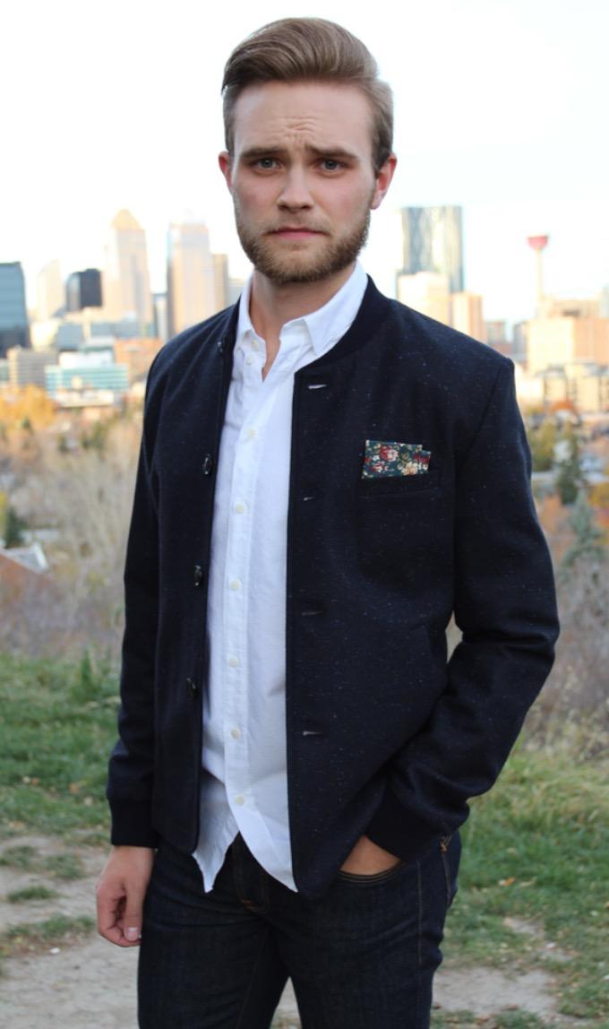Adam is wearing clothing from Modern Menswear,