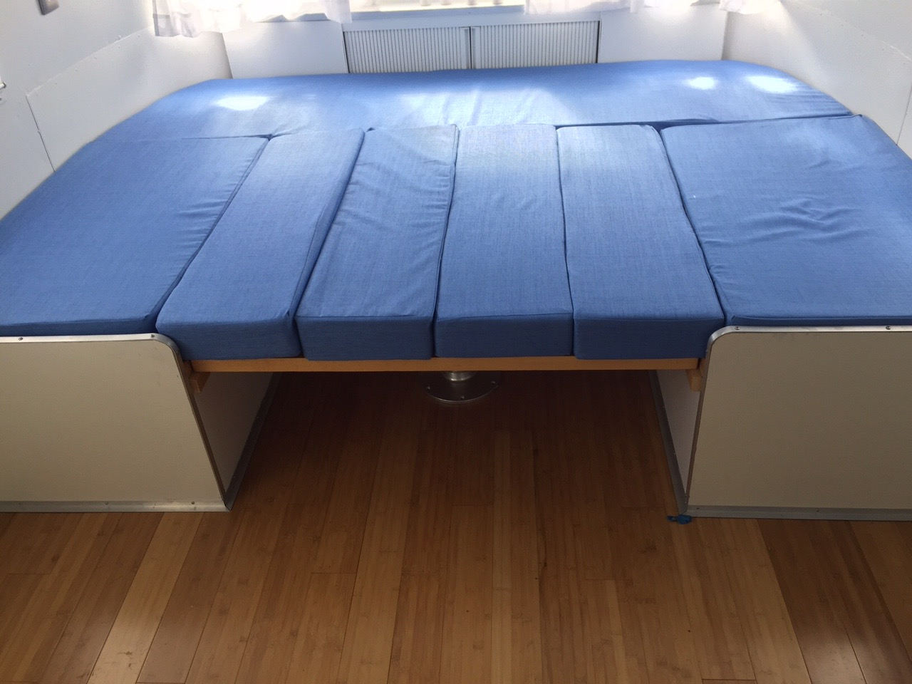 Cushions fold out to make a very comfortable roomy mattress, a little larger than queen size