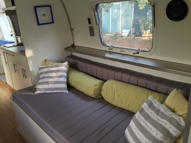 Rear twin bed with bamboo lined storage underneath