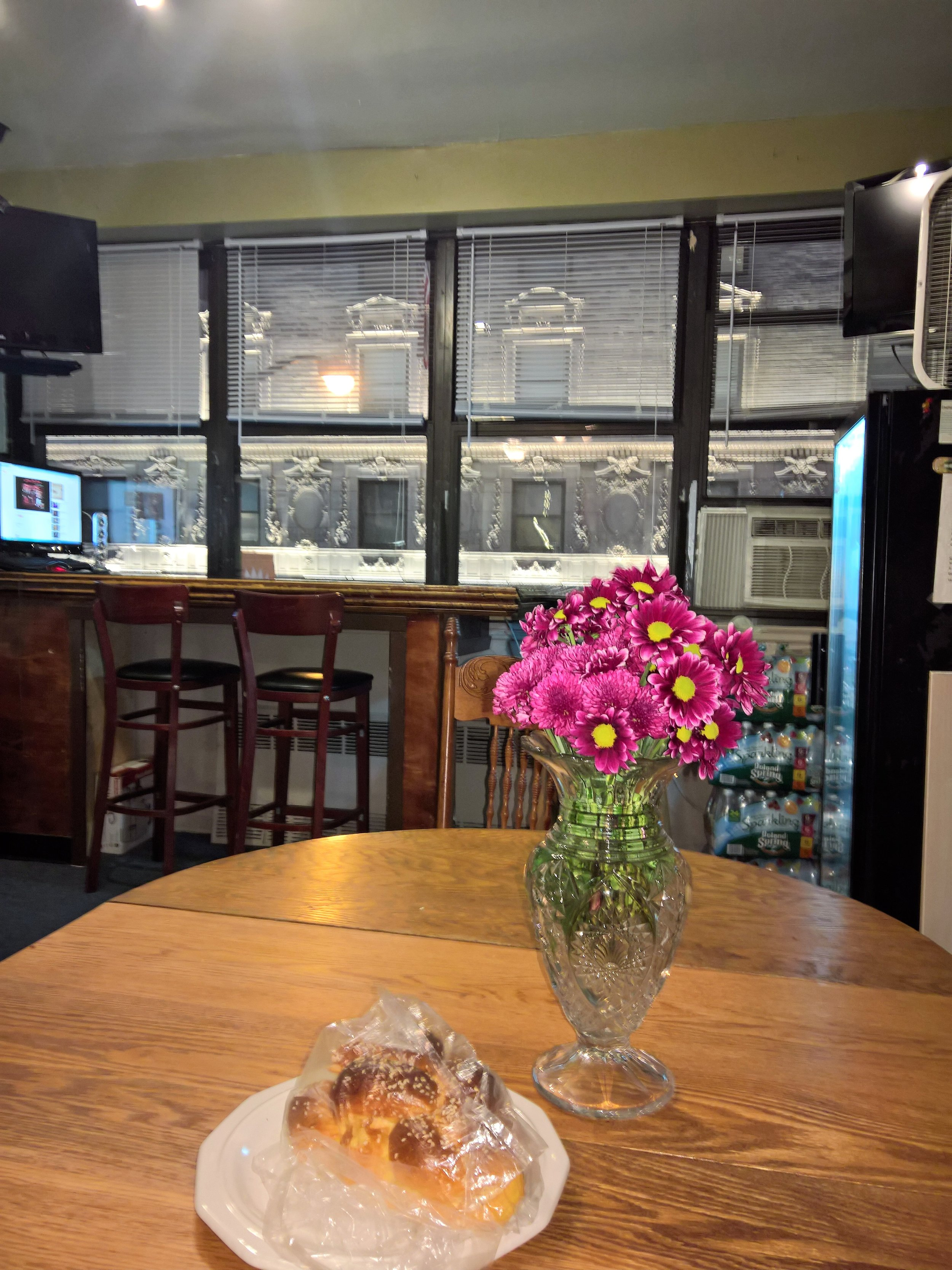 46th_street_clubhouse_door_table_with_flowers.jpg