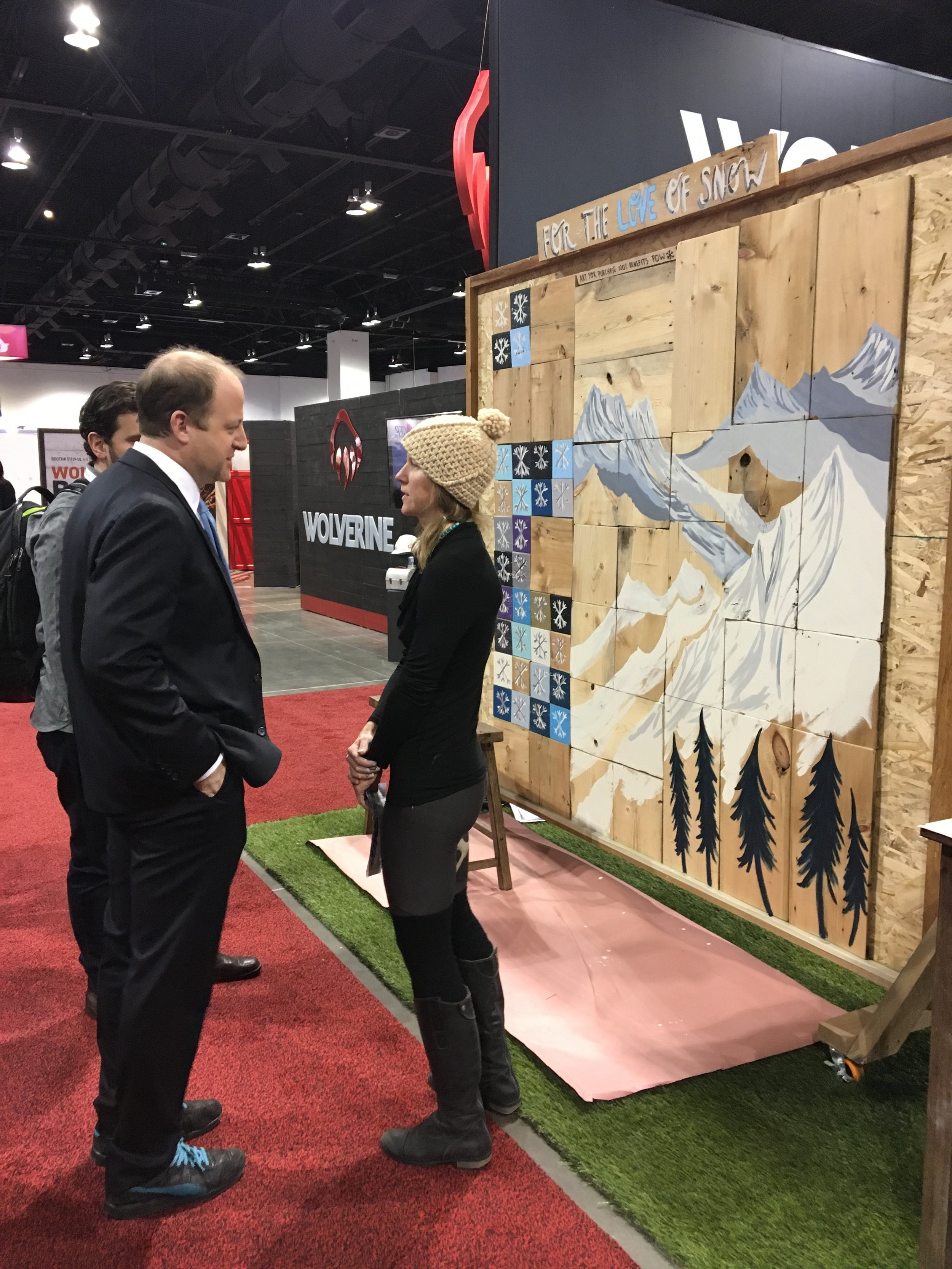 Colorado Governor Jared Polis stops by to learn about the mural and the work POW is doing at Outdoor Retailer
