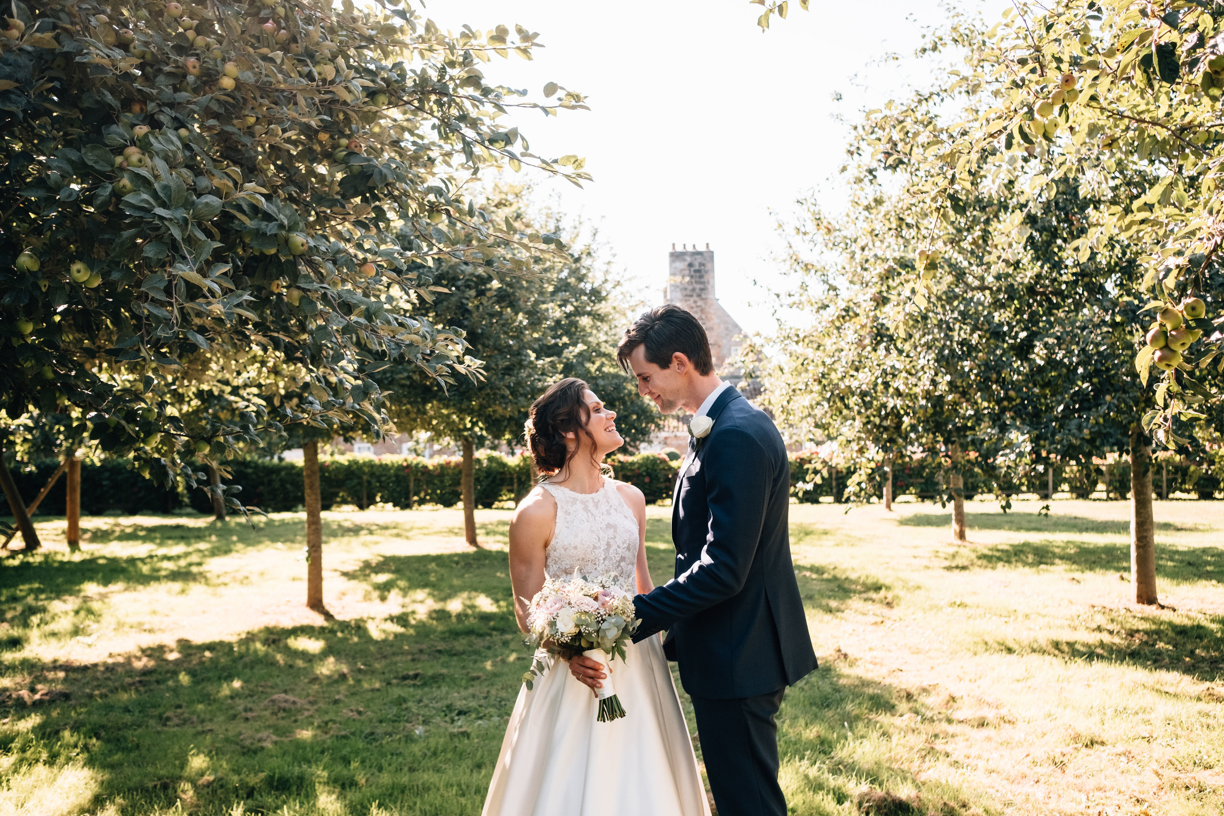 Documentary wedding photo of a couple in a vineyard getting married in the UK
