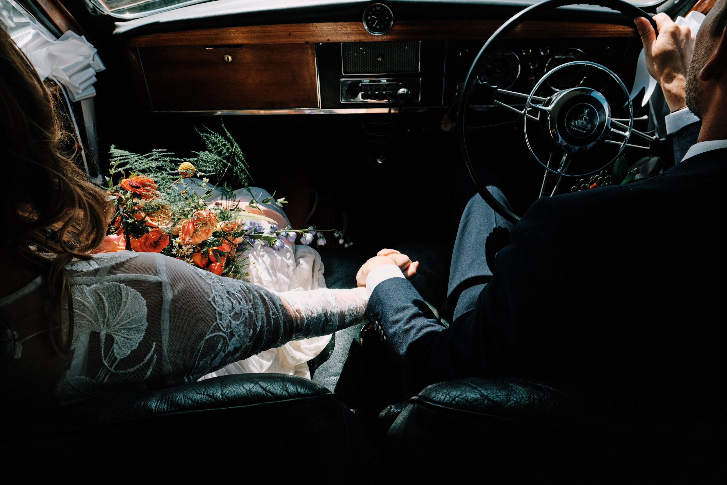 Bride and Groom vintage car holding hands natural light documentary photography