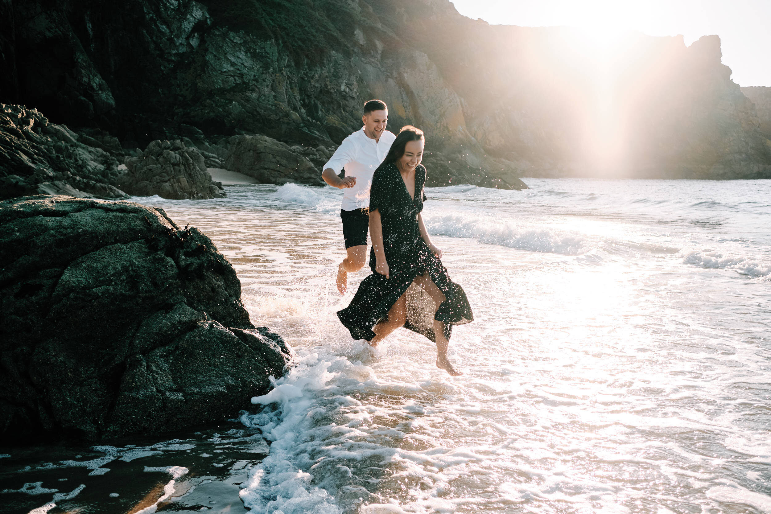 Couple Shoot on the beach at sunset in the sea 2020 wedding planner