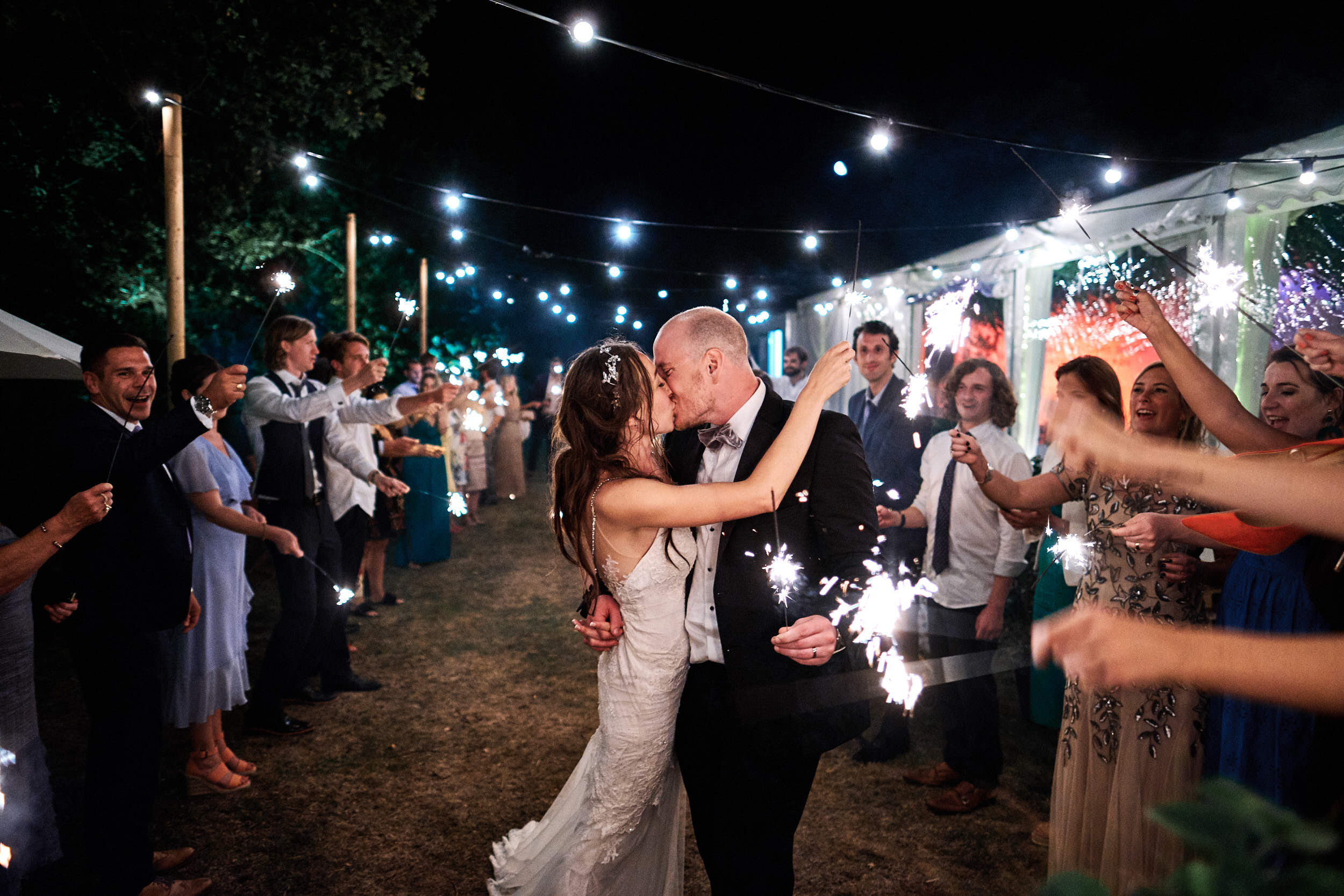 Documentary wedding photo of a couple holding sparklers in 2020