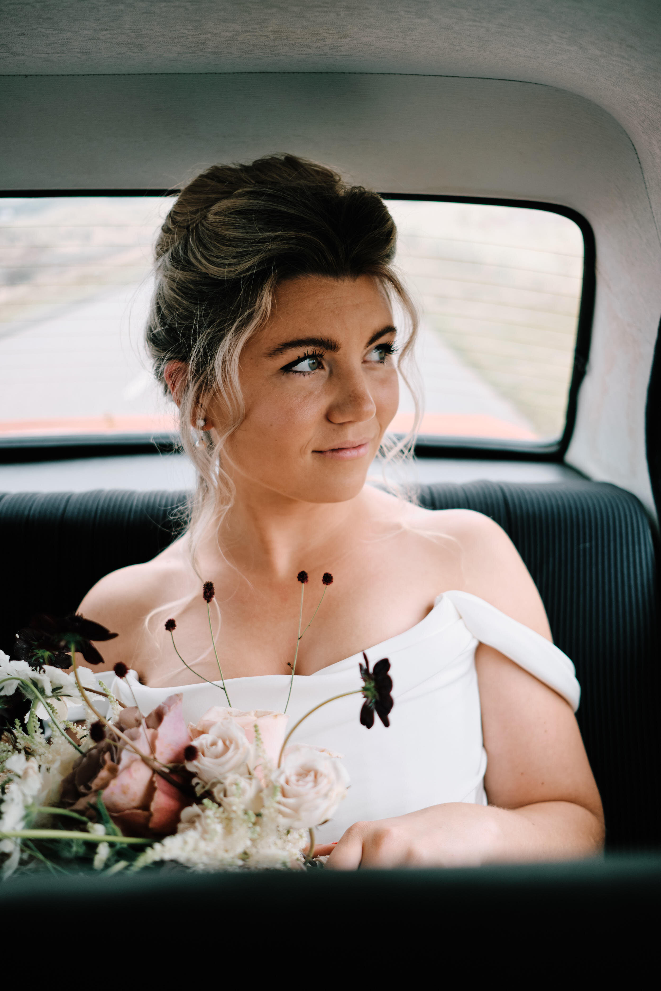 Bride on her way to ceremony vintage car documentary wedding photography 2020