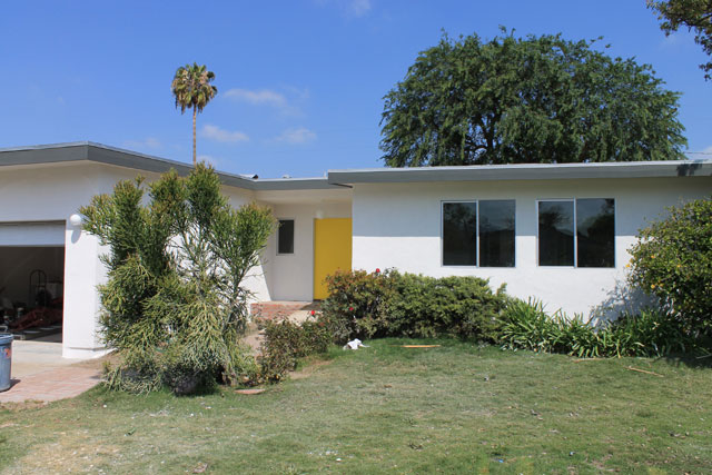 The house got all new white stucco, all new aluminum windows, A/C taken off the roof, and a yellow door for pop.