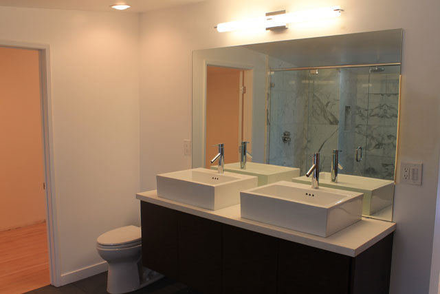 The master bath turned out amazing and feels like a boutique hotel.  The shower is a dream with it's size, Hansgrohe rain shower head, and statuary marble.  The freestanding tub fills the space perfectly.  The double sinks on top of the same quartz counters and cabinetry as in the kitchen turned out nicely as well.  There is also a vanity area next to the bathtub.